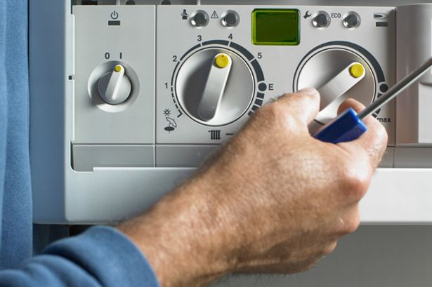 customer-service-man-fixing-boiler-pic-getty-images-915401668